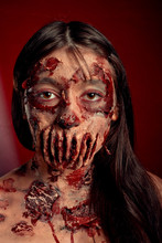 Zombie Girl Portrait On A Red Background, Halloween