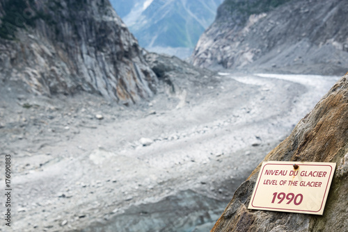 Glaciers Sign indicating the level of the Glacier Mer de Glace in 1990, glacier melting illustration, in Chamonix Mont Blanc Massif, The Alps, France