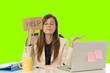 Leinwanddruck Bild - young attractive sad and desperate businesswoman suffering stress at office laptop computer desk green croma key background