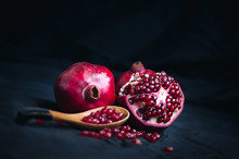 Fresh Pomegranate On A Black B...