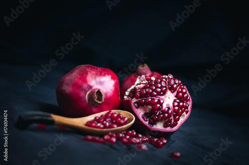 Fototapeta fresh pomegranate on a black background