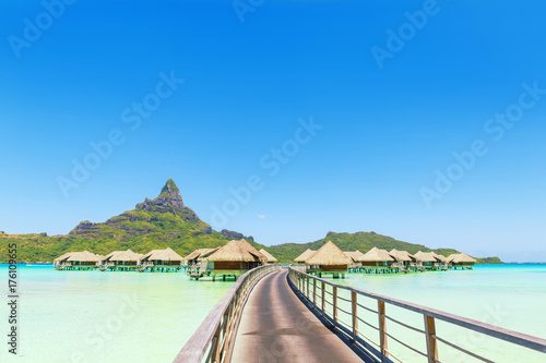 canvas print motiv - 18042011 : Overwater pass to villas on a tropical lagoon of Bora Bora Island, Tahiti, French Polynesia
