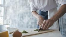 Close Up Of Chef Chopping Gree...