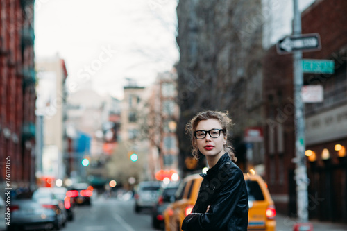 Professional woman looking at camera on the streets of New York City Poster