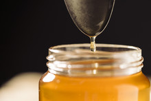 A Spoon Dropping Honey