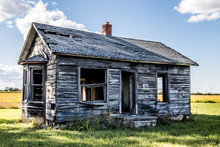 Old Abandoned Small House On Field