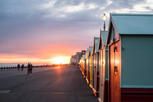 Colorful Beach Huts During Sun...
