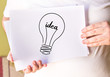 Lightbulb creative idea abstract icon on white paper