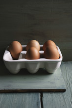 Five Eggs In A Ceramic Egg Car...
