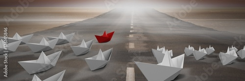 Group of Paper boats on road