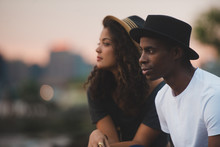 Young Man And Woman Watching Sunset