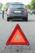 warning triangle behind stalled car