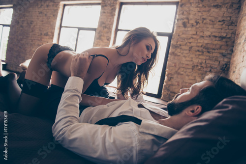 Fotografía  Young naughty  gorgeous brunette lady is undressing her bearded lover is classy