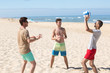 boys playing beach volleyball