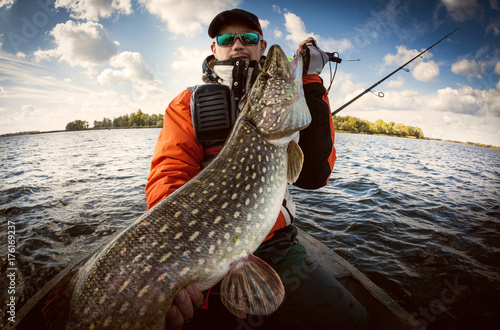 Printed kitchen splashbacks Fishing Fishing. Fisherman and trophy Pike.