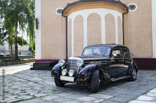 Photo  Old Mercedes car in front of church