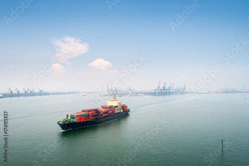 Aluminium Prints Port container ship sails out of the harbor