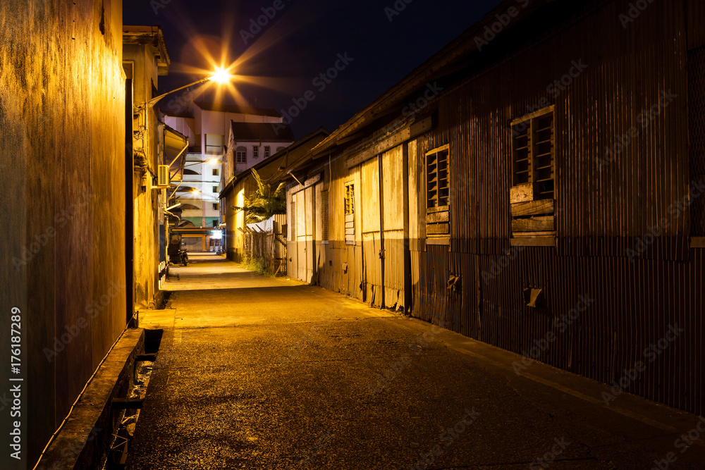 Fototapeta Urban city alley at night in asia
