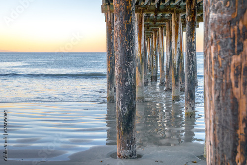 Avila Beach Pier view of pillars under during sunrise