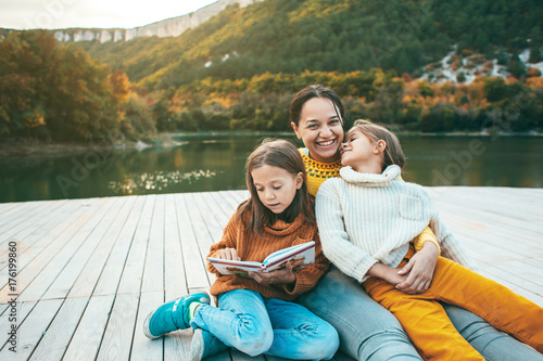 Family spending time together by the lake