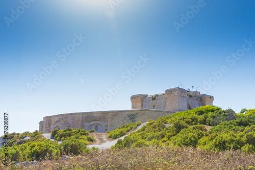 Foto op Plexiglas Lavendel St. Lucians Tower or It-Torri ta' San Lucjan in Maltese, a large fortified Knights of St John watchtower overlooking Marsaxlokk Bay, Malta, June 2017