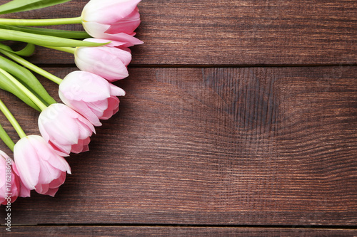 bouquet-of-tulips-on-brown-wooden-table