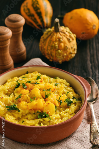 Risotto with pumpkin, cheese and parsley.