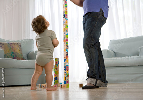 Baby watching father Canvas Print