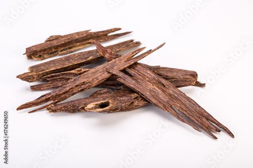 Photo Close Up Macro Shot Of Sticks Of Agar Wood Or Agarwood Isolated On White Backgro