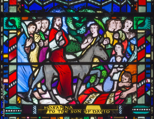 LONDON, GREAT BRITAIN - SEPTEMBER 16, 2017: The stained glass of Palm Sundy - Entry of Jesus in Jerusalem in church St Etheldreda by Charles Blakeman (1953 - 1953).