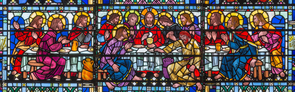 Fototapeta LONDON, GREAT BRITAIN - SEPTEMBER 16, 2017: The stained glass of Last Supper the Pantokrator in church St Etheldreda by Joseph Edward Nuttgens (1952).