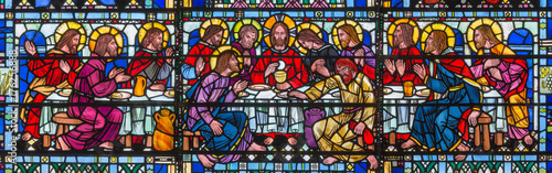 Photo Stands Historical buildings LONDON, GREAT BRITAIN - SEPTEMBER 16, 2017: The stained glass of Last Supper the Pantokrator in church St Etheldreda by Joseph Edward Nuttgens (1952).