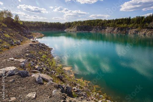 Foto op Plexiglas Purper Abandoned flooded open pit quarry mine abestos ore with blue water
