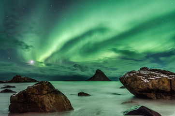Polar light on a beach of Andenes in Norway (aurora borealis)