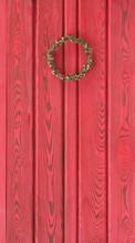 Flower Wreath On The Red Door