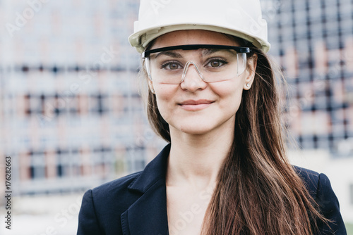 Beautiful woman civil engineer close up portrait in front