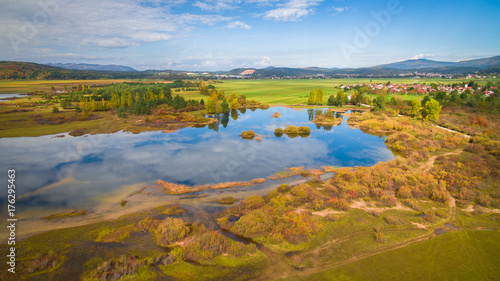 Deurstickers Asia land Aerial drone view of amazing autumn colors on the lake. Cerknisko lake, Slovenia