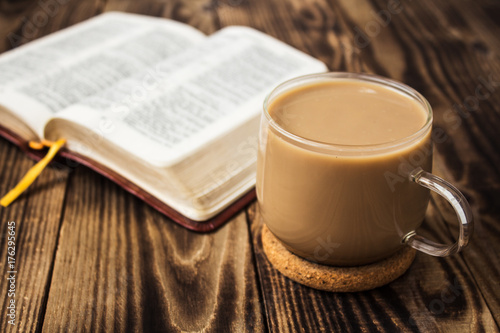 Wall Murals Cafe a cup of coffee and bible on wooden background