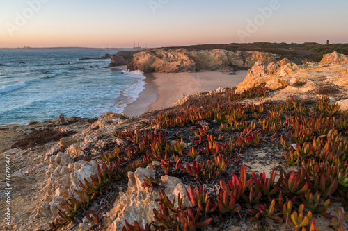 Sunset in beach with rocks in Porto Covo in Alentejo, Portugal Canvas Print