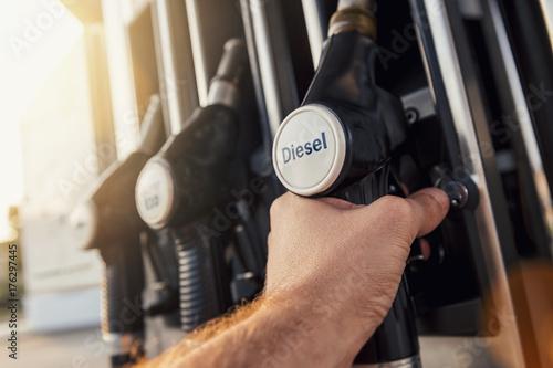 Male Hand grab fuel gas nozzle Canvas Print