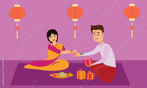 Photo  Indian young sister tying rakhi thread to his brother wrist celebrating Rakhi festival or Rakshabandhan in traditional attire