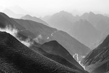 Winding mountain road on the Tibetan plateau black-and-white photo. - 176307801