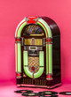 Leinwanddruck Bild - vintage jukebox on pink background in pin-up style