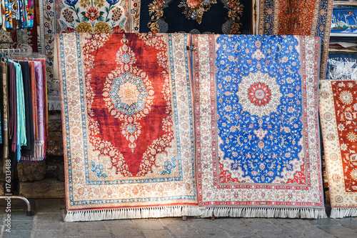 Wall Murals Imagination Two colorful silk carpets and rugs at the store in Istanbul Bazar, Turkey