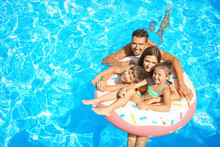 Happy Family With Inflatable R...