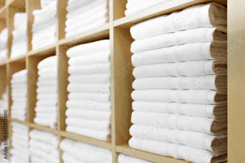 Fotografie, Obraz  Fresh White Hotel Towels Folded and Stacked on a Shelf