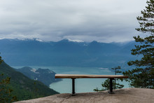 Empty Bench On Top Of A Cliff Overlooking The Howe Sound.