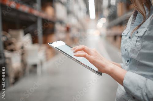Fototapeta stock taking. beautiful young woman worker of furniture store. obraz na płótnie