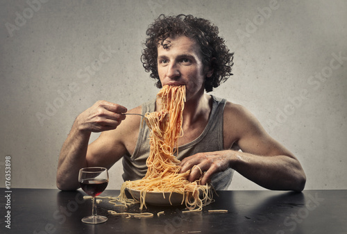 Greedy man eating spaghetti Fototapeta