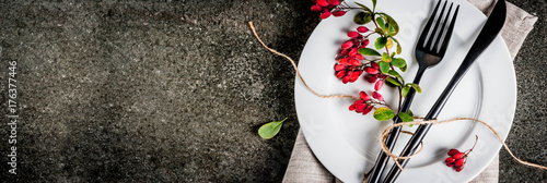 Fototapeta Autumn food background concept. Thanksgiving dinner, Dark stone table with set of cutlery knife, fork with fall berries like decoration. Black background. Copy space banner top view obraz